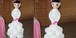 Nena de comunió amb globus, gran Foto 1